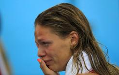 2016 Rio Olympics - Swimming - Final - Women's 100m Breaststroke Final - Olympic Aquatics Stadium - Rio de Janeiro, Brazil - 08/08/2016. Yulia Efimova (RUS) of Russia cries.  REUTERS/Dominic Ebenbichler