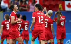 2016 Rio Olympics - Soccer - Preliminary - Women's First Round - Group F Germany v Canada - Mane Garrincha Stadium - Brasilia, Brazil - 09/08/2016.  Melissa Tancredi (CAN) (L) of Canada celebrates with teammate Christine Sinclair after Canada defeated Germany.  REUTERS/Ueslei Marcelino