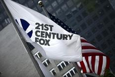 The flag of the Twenty-First Century Fox Inc is seen waving at the company headquarters in the Manhattan borough in New York, New York, U.S. June 11, 2015.   REUTERS/Eduardo Munoz