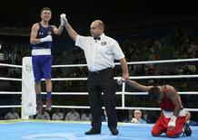 Nico Miguel Hernandez (USA) of USA celebrates after winning his bout against Carlos Quipo (ECU) of Ecuador. REUTERS/Adrees Latif
