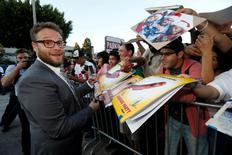 "Cast member Seth Rogen signs autographs at the premiere for the movie ""Sausage Party"" in Los Angeles, California U.S., August 9, 2016.   REUTERS/Mario Anzuoni"