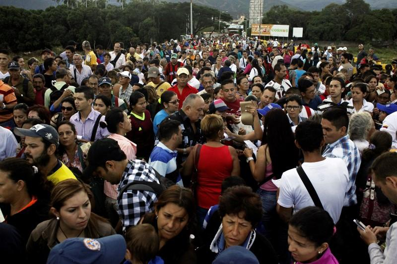 Venezuelans cross reopened border to Colombia for food, medicine