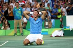 2016 Rio Olympics - Tennis - Semifinal - Men's Singles Semifinals - Olympic Tennis Centre - Rio de Janeiro, Brazil - 13/08/2016. Juan Martin Del Potro (ARG) of Argentina celebrates after winning match against Rafael Nadal (ESP) of Spain.    REUTERS/Kevin Lamarque