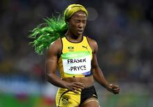 2016 Rio Olympics - Athletics - Semifinal - Women's 100m Semifinals - Olympic Stadium - Rio de Janeiro, Brazil  13/08/2016. Shelly-Ann Fraser-Pryce (JAM) of Jamaica reacts after the race    REUTERS/Dylan Martinez
