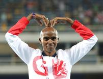 2016 Rio Olympics - Athletics - Victory Ceremony - Men's 10,000m Victory Ceremony - Olympic Stadium - Rio de Janeiro, Brazil - 13/08/2016. Mo Farah (GBR) of Britain celebrates on podium.  REUTERS/Alessandro Bianchi
