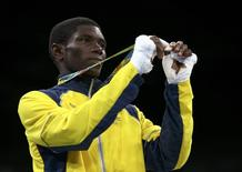 2016 Rio Olympics - Boxing - Victory Ceremony - Men's Light Fly (49kg) Victory Ceremony - Riocentro - Pavilion 6 - Rio de Janeiro, Brazil - 14/08/2016. Yuberjen Martinez Rivas (COL) of Colombia poses with his silver medal during the victory ceremony. REUTERS/Peter Cziborra