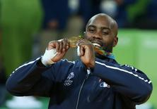 2016 Rio Olympics - Judo - Victory Ceremony - Men +100 kg Victory Ceremony - Carioca Arena 2 - Rio de Janeiro, Brazil - 12/08/2016. Teddy Riner (FRA) of France poses with his medal. REUTERS/Toru Hanai