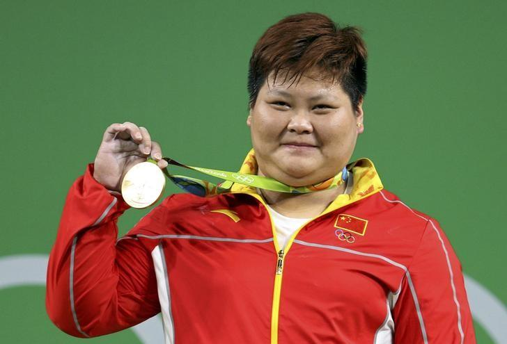 China top table again; Robles ends long U.S. wait