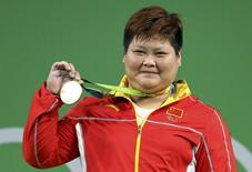 2016 Rio Olympics - Weightlifting - Victory Ceremony - Women's +75kg Victory Ceremony - Riocentro - Pavilion 2 - Rio de Janeiro, Brazil - 14/08/2016. Meng Suping (CHN) of China poses with her gold medal. REUTERS/Stoyan Nenov