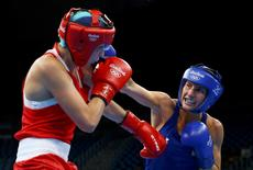 2016 Rio Olympics - Boxing - Quarterfinal - Women's Light (60kg) Quarterfinals Bout 211 - Riocentro - Pavilion 6 - Rio de Janeiro, Brazil - 15/08/2016. Anastasia Belyakova (RUS) of Russia and Mikaela Mayer (USA) of USA compete. REUTERS/Peter Cziborra