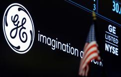 The ticker and logo for General Electric Co. is displayed on a screen at the post where it's traded on the floor of the New York Stock Exchange (NYSE) in New York City, U.S., June 30, 2016.  REUTERS/Brendan McDermid - RTX2J376
