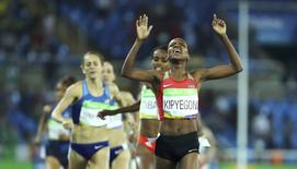 2016 Rio Olympics - Athletics - Final - Women's 1500m Final - Olympic Stadium - Rio de Janeiro, Brazil - 16/08/2016. Faith Chepngetich Kipyegon (KEN) of Kenya celebrates winning the gold. REUTERS/Lucy Nicholson