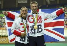 2016 Rio Olympics - Cycling Track - Victory Ceremony - Men's Keirin Victory Ceremony - Rio Olympic Velodrome - Rio de Janeiro, Brazil - 16/08/2016. Gold medalist Jason Kenny (GBR) of Britain poses with his gilfriend, women's omnium gold medalist Laura Trott (GBR) of Britain.   REUTERS/Matthew Childs
