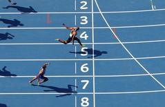 Canada corsses the finish line ahead of Ashton Eaton of USA.  REUTERS/Fabrizio Bensch