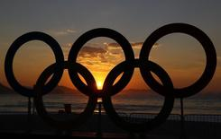 2016 Rio Olympics - Cycling Road - Final - Men's Road Race - Fort Copacabana - Rio de Janeiro, Brazil - 06/08/2016. The Olympic rings are seen as the sun rises over Fort Copacabana ahead of the Men's Road Race.     REUTERS/Paul Hanna