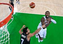 Aug 17, 2016; Rio de Janeiro, Brazil;  USA guard Kyrie Irving (10) loses control of the ball against Argentina point guard Facundo Campazzo (7) during the men's basketball quarterfinals in the Rio 2016 Summer Olympic Games at Carioca Arena 1. Mandatory Credit: USA TODAY Sports