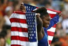 2016 Rio Olympics - Athletics - Final - Women's Long Jump Final - Olympic Stadium - Rio de Janeiro, Brazil - 17/08/2016. Tianna Bartoletta (USA) of USA celebrates winning the gold medal.  REUTERS/Alessandro Bianchi