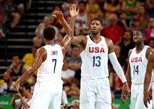 Aug 17, 2016; Rio de Janeiro, Brazil;  USA guard Paul George (13) celebrators with USA guard Kyle Lowry (7) against Argentina during the men's basketball quarterfinals in the Rio 2016 Summer Olympic Games at Carioca Arena 1. Mandatory Credit: Jason Getz-USA TODAY Sports