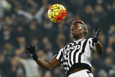 Football Soccer - Juventus v Napoli - Italian Serie A - Juventus Stadium, Turin, Italy - 13/02/16   Juventus' Paul Pogba jumps for the ball. REUTERS/Stefano Rellandini/Files
