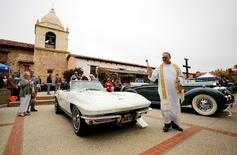 Bishop Richard Garcia blesses a 1965 Corvette, owned by Mike Vietro, during the Carmel Mission Classic, in Carmel-by-the-Sea, California, U.S. August 17, 2016. REUTERS/Michael Fiala