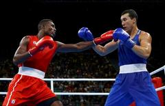 2016 Rio Olympics - Boxing - Final - Men's Light Heavy (81kg) Final Bout 257 - Riocentro - Pavilion 6 - Rio de Janeiro, Brazil - 18/08/2016. Julio Cesar La Cruz (CUB) of Cuba and Adilbek Niyazymbetov (KAZ) of Kazakhstan compete.  REUTERS/Peter Cziborra