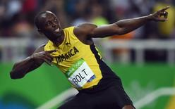 2016 Rio Olympics - Athletics - Final - Men's 200m Final - Olympic Stadium - Rio de Janeiro, Brazil -18/08/2016. Usain Bolt (JAM) of Jamaica  celebrates after winning gold    REUTERS/Dylan Martinez