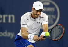 Aug 18, 2016; Mason, OH, USA; Andy Murray (GBR) returns a shot against Kevin Anderson (USA) on day six during the Western and Southern tennis tournament at Linder Family Tennis Center. Mandatory Credit: Aaron Doster-USA TODAY Sports