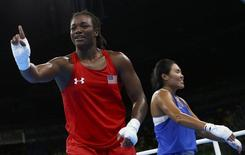 2016 Rio Olympics - Boxing - Semifinal - Women's Middle (75kg) Semifinals Bout 264 - Riocentro - Pavilion 6 - Rio de Janeiro, Brazil - 19/08/2016. Claressa Shields (USA) of USA celebrates after winning her bout against Dariga Shakimova (KAZ) of Kazakhstan. REUTERS/Peter Cziborra
