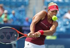 Angelique Kerber (GER) returns a shot against Carla Suarez Navarro (ESP) in the quarterfinals during the Western and Southern tennis tournament at Linder Family Tennis Center. Mandatory Credit: Aaron Doster-USA TODAY Sports