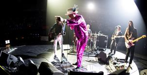 "Tragically Hip lead singer Gord Downie performs with band members Paul Langlois, Gord Sinclair, Johnny Fay and Rob Baker at the Save-on-Foods Memorial Centre to kick off the band's latest ""Man Machine Poem"" tour in light of Downie's brain cancer diagnosis, in Victoria, B.C., Canada July 22, 2016. REUTERS/Kevin Light"