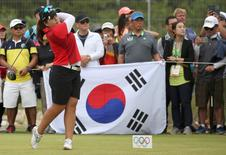2016 Rio Olympics - Golf - Final - Women's Individual Stroke Play - Olympic Golf Course - Rio de Janeiro, Brazil - 20/08/2016.   Inbee Park (KOR) of Korea watches her tee shot on the 15th hole during final round women's Olympic golf competition.     REUTERS/Andrew Boyers