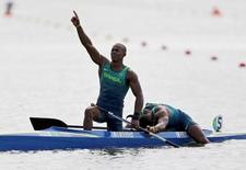 2016 Rio Olympics - Canoe Sprint - Final - Men's Canoe Double (C2) 1000m - Final A - Lagoa Stadium - Rio de Janeiro, Brazil - 20/08/2016. Erlon de Souza Silva (BRA) of Brazil and Isaquias Queiroz Dos Santos (BRA) of Brazil celebrate winning silver after the men's canoe double (C2) 1000m race.  REUTERS/Marcos Brindicci