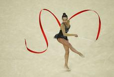 2016 Rio Olympics - Rhythmic Gymnastics - Final - Individual All-Around Final - Rotation 4 - Rio Olympic Arena - Rio de Janeiro, Brazil - 20/08/2016. Margarita Mamun (RUS) of Russia competes using the ribbon. REUTERS/Ruben Sprich