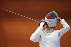 2016 Rio Olympics - Fencing - Women's Training - Riocentro - Rio De Janeiro, Brazil - 31/07/2016. Venezuela's Alejandra Benitez adjusts her mask in practices.  REUTERS/Edgard Garrido