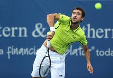Aug 15, 2016; Mason, OH, USA; Marin Cilic (CRO) returns a shot against Viktor Troicki (SRB) on day three during the Western and Southern tennis tournament at Linder Family Tennis Center. Mandatory Credit: Aaron Doster-USA TODAY Sports