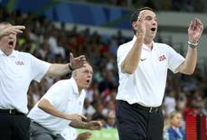 2016 Rio Olympics - Basketball - Semifinal - Men's Semifinal Spain v USA - Carioca Arena 1 - Rio de Janeiro, Brazil - 19/8/2016.   Coach Mike Krzyzewski (USA) of the USA (R) cheers his team during the game.  REUTERS/Shannon Stapleton
