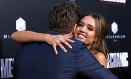Cast member Jessica Alba hugs director of the movie Dennis Gansel.   REUTERS/Mario Anzuoni