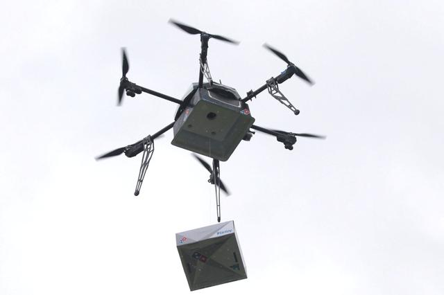 A delivery drone performs a test flight with a Domino's pizza box in Auckland, New Zealand, August 25, 2016.   Domino's/Handout via REUTERS