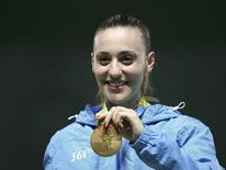 2016 Rio Olympics - Shooting - Victory Ceremony - Women's 25m Pistol Victory Ceremony - Olympic Shooting Centre - Rio de Janeiro, Brazil - 09/08/2016. Anna Korakaki (GRE) of Greece poses with her gold medal.  REUTERS/Edgard Garrido