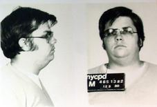 A mug-shot of Mark David Chapman, who shot and killed John Lennon, is displayed on the 25th anniversary of Lennon's death at the NYPD in New York December 8, 2005.