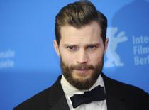Actor Jamie Dornan arrives for the screening of the movie 'Fifty Shades of Grey' at the 65th Berlinale International Film Festival in Berlin February 11, 2015.                        REUTERS/Stefanie Loos