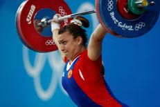 Nadezda Evstyukhina of Russia competes in the women's 75kg Group A weightlifting snatch competition at the Beijing 2008 Olympic Games August 15, 2008.          REUTERS/Yves Herman