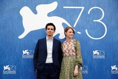 "Director Damien Chazelle (L) and actress Emma Stone (R) attend the photocall for the movie ""La La Land""  at the 73rd Venice Film Festival in Venice, Italy August 31, 2016. REUTERS/Alessandro Bianchi"