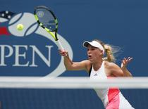 Aug 31, 2016; New York, NY, USA; Caroline Wozniacki of Denmark hits to Svetlana Kuznetsova of Russia on day three of the 2016 U.S. Open tennis tournament at USTA Billie Jean King National Tennis Center. Mandatory Credit: Jerry Lai-USA TODAY Sports