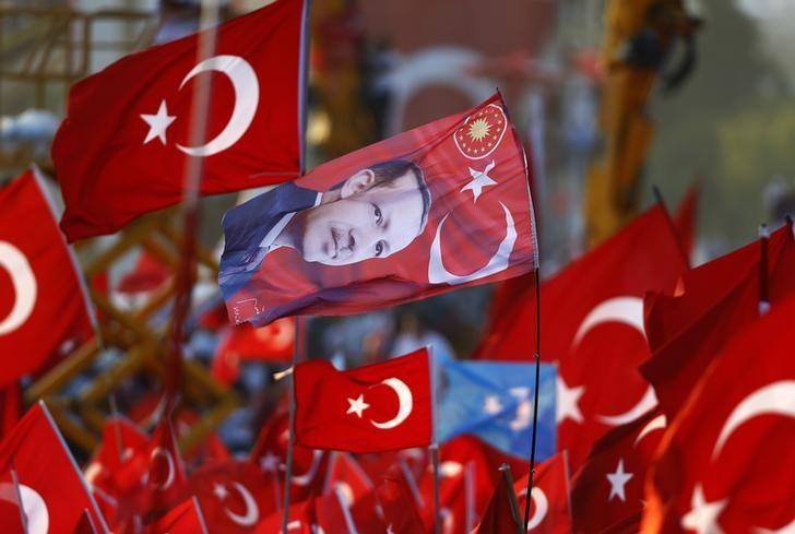 A flag with the picture of Turkey's President Tayyip Erdogan is seen during the Democracy and Martyrs Rally, organized by him and supported by ruling AK Party (AKP), oppositions Republican People's Party (CHP) and Nationalist Movement Party (MHP), to protest against failed military coup attempt, in Istanbul, Turkey, August 7, 2016.  REUTERS/Osman Orsal
