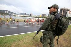 2016 Rio Olympics - Athletics - Final - Men's Marathon - Sambodromo - Rio de Janeiro, Brazil - 21/08/2016. A military ensures security as athletes compete.  REUTERS/Eric Gaillard