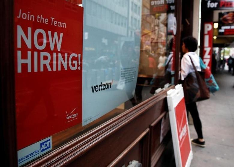 A ''Now Hiring'' sign is posted on a Verizon store in Manhattan in New York City, U.S. on May 10, 2016.  REUTERS/Brendan McDermid/File Photo