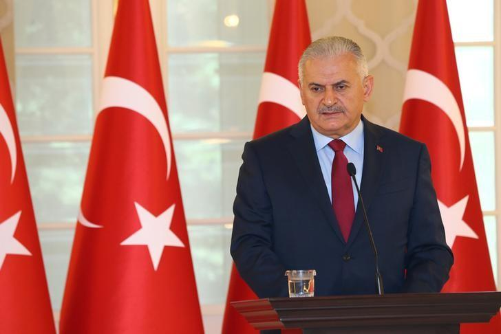 Turkish Prime Minister Binali Yildirim speaks during a news conference in Ankara, Turkey, July 19, 2016 in this handout photo provided by the Prime Minister's Press Office. Hakan Goktepe/Prime Minister's Press Office/Handout via REUTERS/Files