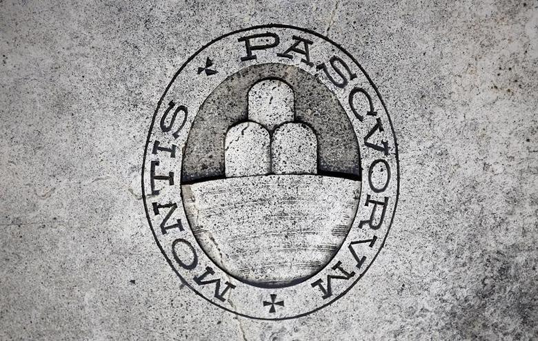 A logo of Monte dei Paschi di Siena bank is seen on the ground in downtown Siena, Italy, November 5, 2014. REUTERS/Giampiero Sposito/File Photo