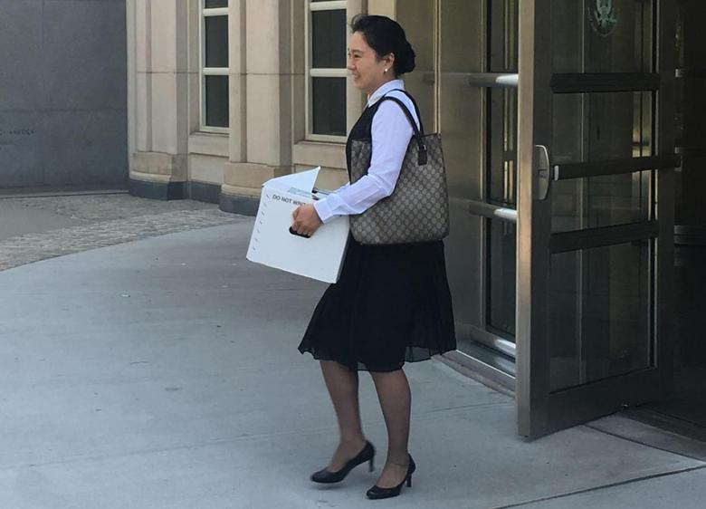 Former Air China employee Ying Lin exits the building after a pretrial hearing in federal court in Brooklyn, New York, U.S. on June 21, 2016.  Picture taken June 21, 2016. REUTERS/Nate Raymond